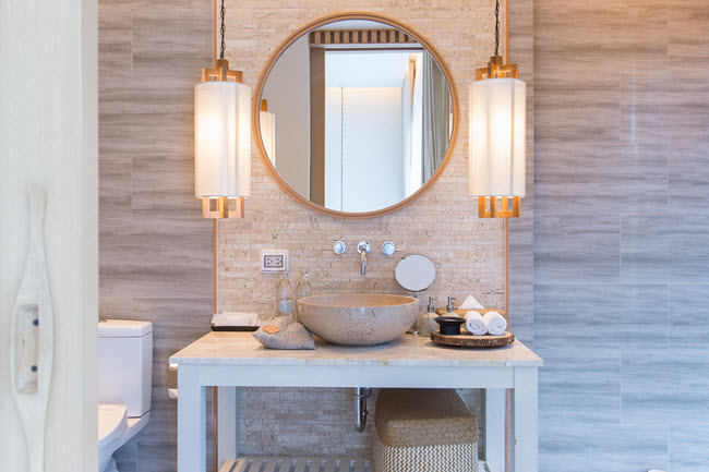 In a bathroom renovation, plan for overlapping pools of light, which give you maximum flexibility.
