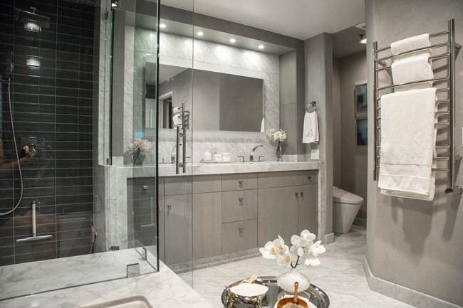 Replace oversized tubs with a steam shower.