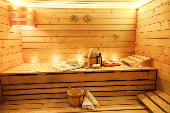 Saunas are traditionally constructed from kiln-dried wood (often cedar or spruce) that can withstand the much higher temperatures and lower humidity.