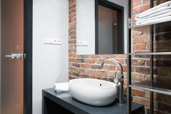 A trendy oval sink take up less counter space than a square.