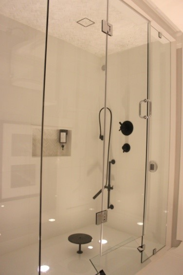 Both your shower stall and tub will benefit from clear glass enclosures, with minimal hardware.