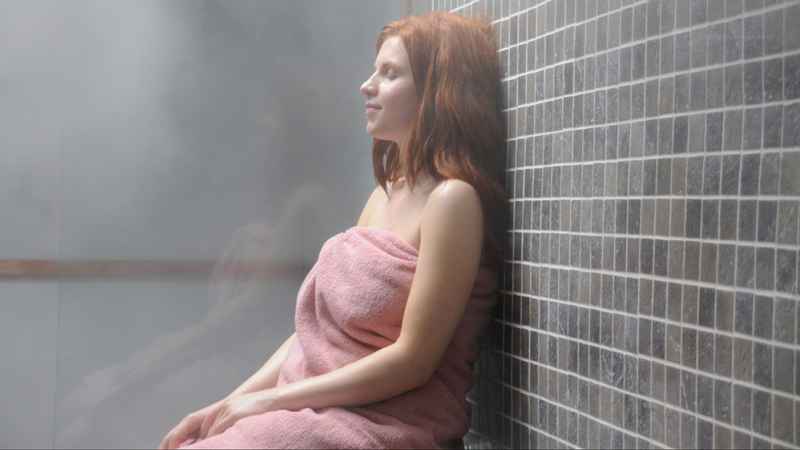 Rest and rejuvenate in your home steam shower spa sanctuary.