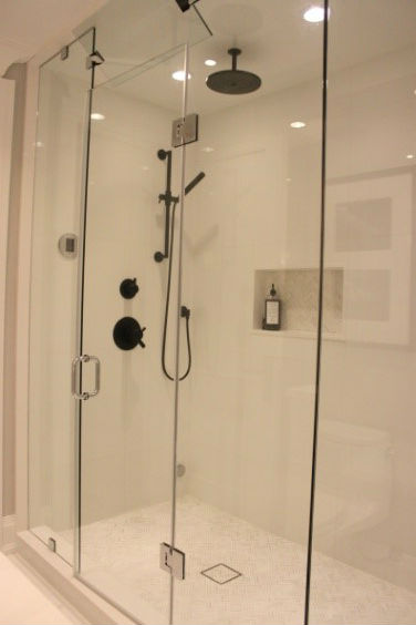 Open up the bathroom with glass shower enclosures